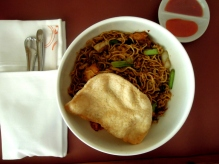 Mie goreng (fried noodles with seafood, pickles,