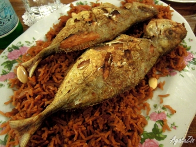 Aysh Mohammar ma Samak Magli (rice cooked in dates syrup with pan fried fish)